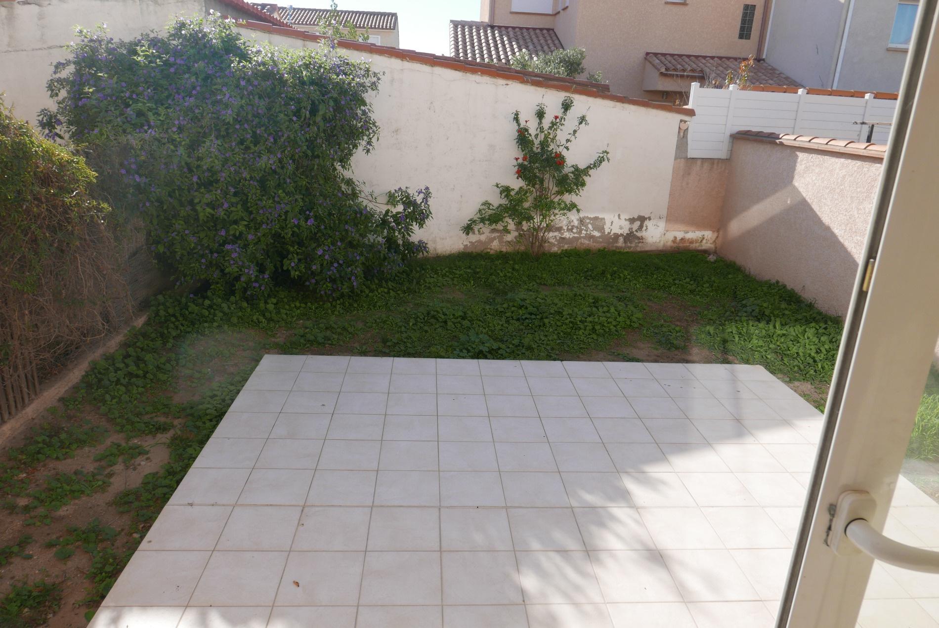 Terrasse arriere avec jardinet