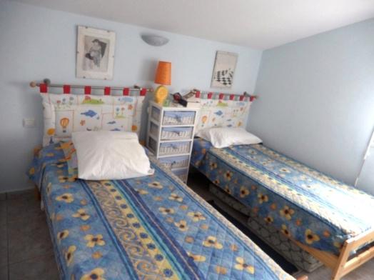 Chambre avec 2 lits en 80